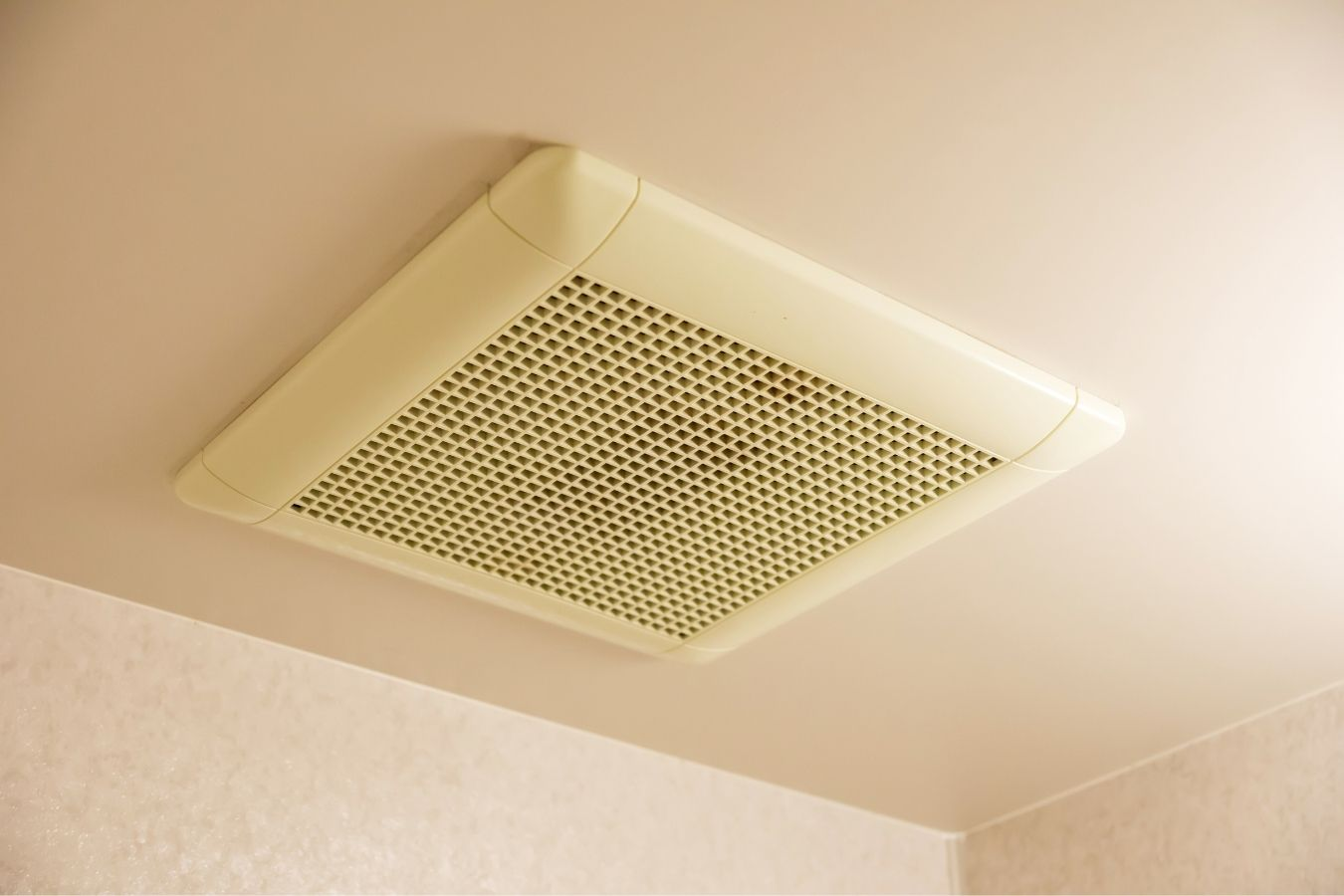 A duct fan installed in a bathroom