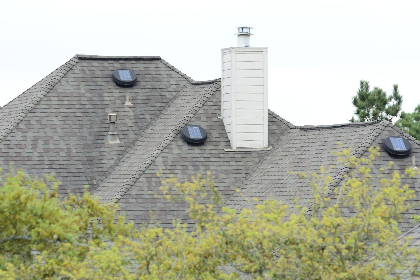 Image of solar attic vents, solar attic fans on the roof of a house